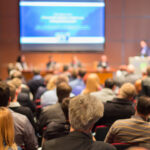 A conference room full of people at an Ellicott business conference venue as they provide a checklist for planning your business conference