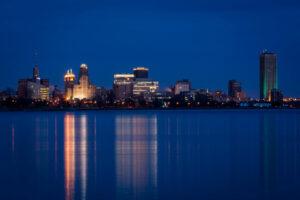 Buffalo waterfront skyline at night while Ellicott Development lists the best waterfrint restaurants