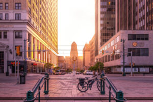 A phot of downtown Buffalo New York at sunset as Ellicott Development lists available office rental properties in Buffalo